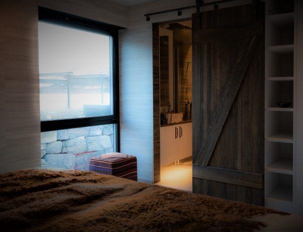 bedroom and door leading to ensuite bathroom