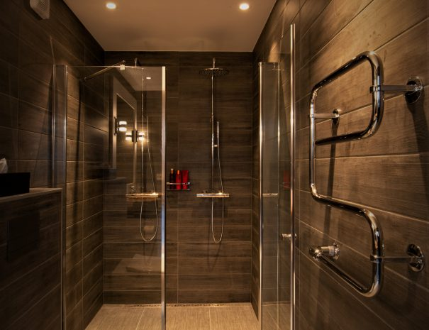 bathroom with double showers and toilet