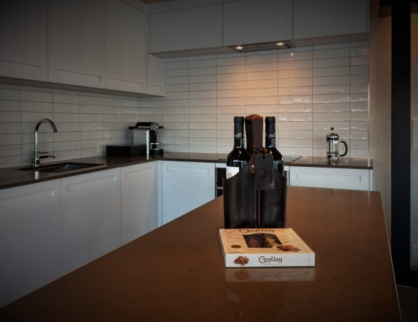 kitchen with wine bottles placed on island