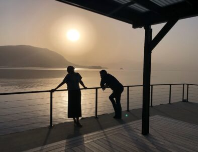 two people on the terrace in front of the sea